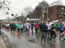 annual holiday race brings runners downtown news sports jobs runners take off from the start line just moments after david reinhardt chautauqua striders athletic