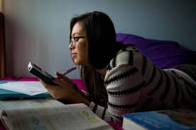 Featured in the      Book of Dreams  Melanie Ocon works on homework at home in