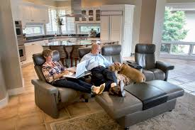 room ergonomic furniture chairs: jennifer and roland palmer relax in custom seats from ekornes which specializes in ergonomic design credit stephen b morton for the new york times