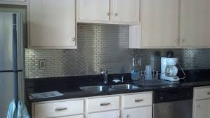 black and stainless kitchen simple stainless steel tile kitchen backsplash with black marble table which has  white drawers