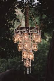 rustic bling wagon wheel and hanging jars chandelier beautiful classic mason jar