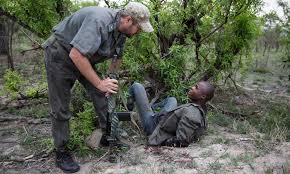why e o wilson is wrong about how to save the earth ideas a member of the military style special ranger patrol talks to a suspected rhino poacher