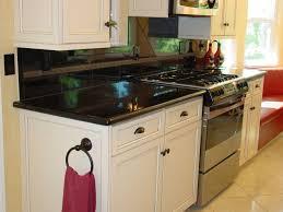 limestone tiles kitchen: kitchen with window seat flat panel cabinets absolute black granite countertop stonemark granite