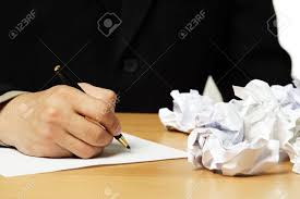 a businessman writing on a piece of paper stock photo picture and a businessman writing on a piece of paper stock photo 1065921