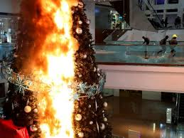Protesters <b>set Christmas tree</b> on fire at a Hong Kong luxury mall ...