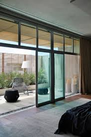 large sliding patio doors: architecture exclusive bachelor pad bedroom interior exterior color combination with large sliding glass door see