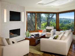 beautiful and simple living room design with tv above fireplace and amazing view beautiful simple living
