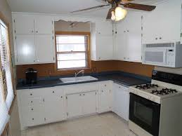 painted kitchen cabinets vintage cream: kitchenalluring white kitchen cabinet also cream marble countertop and arch faucet also under mount