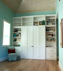 cool bedroom design with murphy bed and white shelves and drawers and turquoise wall paint color awesome murphy bed office