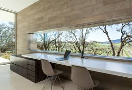 this home office with its 16 foot long window wrapping the view is one of the homes most beautiful spaces the window is set into a wall tiled with local beautiful home office view