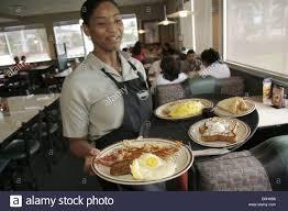 employee waitress adult african stock photos employee waitress hialeah gardens denny s restaurant black w waitress serves food plate eggs job employee stock image