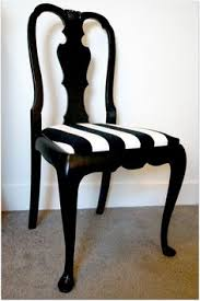 the newly reupholstered pop ups seats have a modern yet classic french style black and white thick stripe upholstery black and white striped furniture