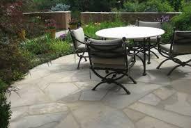 backyard full sprinkler system great tiled patio