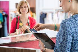 s clerk using tablet pc to receive payment from customer block home s clerk using tablet pc to receive payment from customer