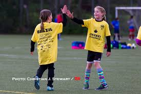 world cups youth soccer festival returns to lochside park a photo team players share a high five following a goal at the 2017 world cups youth