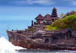 is located on the South coast of the isle of  BaliBeach; Tanah Lot Temple