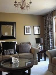 partially my living room now i need to add these pillows and wall art black beige living room