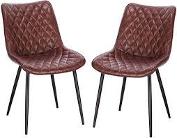 Set of <b>2 dining chairs</b> made of synthetic leather with metal legs ...