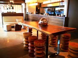 The Breslin Bar And Dining Room Dining Terrific Curvy Surface Of Wooden Stool In Front Of Black
