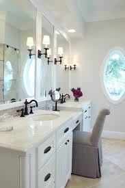 bathroom lighting over mirror bathroom traditional with wall sconce oval window above mirror bathroom lighting