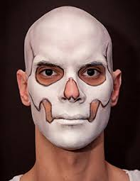 wipe across the surface of the bleached bone foundation to load the sponge once the sponge sugar skull makeup