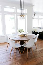 washed pattern dining chair view full a rustic round wood table surrounded by white eames dining chairs crea