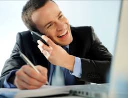 10 easy tips for successful cold calling hirerush blog man on the phone cold calling and maiking notes