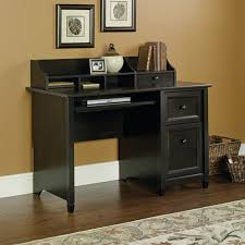 m pine wood computer desk in black finished having open shelves and drawers also short legs placed on brown wooden floor with desks for home office and black desks for home office