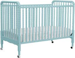 pretty blue davinci jenny lind crib made of wood with wheels for nursery furniture ideas blue nursery furniture