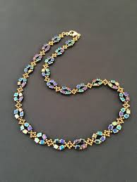 Bronze and metallic blue bead <b>necklace</b>, rainbow blue <b>seed bead</b> ...