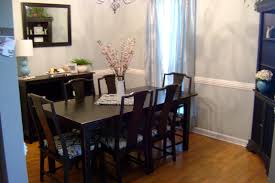 dining room table mirror top: wicker chairs two table lamp tall crystal vase wall mirror door glass purple fabric table cloth dining room centerpieces ideas