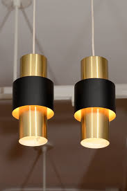 creatives artisan artistic brass pendant light famous creations danish contemporary copper plated cylindrical shapes small simple brass pendant lighting