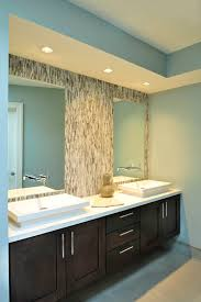 i love the recesssed lights i want to use recessed lights in my bathroom over the sink and vanity but i am hesitating because i have read that it i bathroom recessed lighting