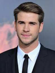 Liam Hemsworth  - 2018 Light brown hair & crew cut hair style.
