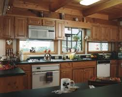 garden window over kitchen sink in timber frame provides light and kitchen lights above sink above sink lighting