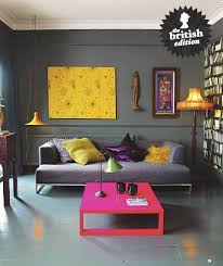 this bohemian chic living room is filled with rich dynamic colors in varying finishes from a luxurious purple satin pillow to the shaggy saffron yellow chic yellow living room