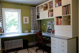 bright green office transitional home office photo in toronto with green walls built in study furniture