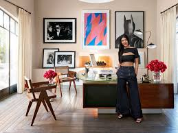 kourtney in her home office which is furnished with a vintage jules leleu desk and architectural digest furniture