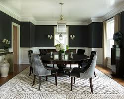 black fabric dining room sofa chair round brown lacquered wood table white and black chevron pattern black lacquer dining room