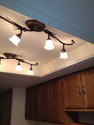 ceiling track lights for kitchen alongside wall mount storage cabinet with bow shaped drawer pulls and ceiling track lighting systems