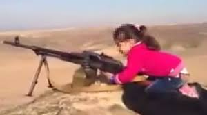 The small Kurdish <b>girl</b> pictured firing a <b>huge</b> machine <b>gun</b> - BBC News
