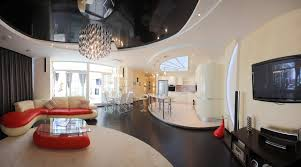 kitchen floor tiles small space: modern bordering on space age living space design with curved design throughout red