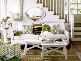 chic veridian homes living room design with white sofa on wooden floor before the white stair chic small white home