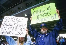 why baseball matters   still fans hold up signs in protest of the baseball strike during a game between the san francisco giants and the chicago cubs at wrigley field in chicago