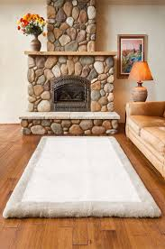 x plush wall: nothing beats the plush comfort and elegance of a sheepskin rug and this short wool x sheepskin area rug is no exception