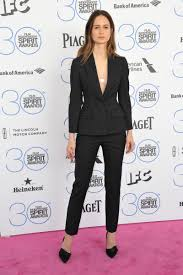 8 ways to wear the pant suit katherine waterson wears a slim cut dior pant suit in black photo shutterstock