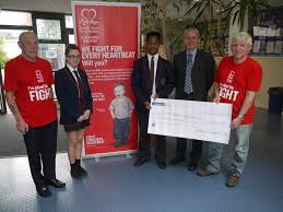 oakgrove integrated college present pound cheque to the british p1140625