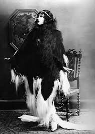 stirred straight up a twist her cloak is trimmed in monkey fur stirred straight up a twist