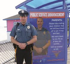 police stop scaring kids that police will arrest you hamodia a police officer in the city of wildwood n j stands in front of a