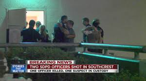 officers console one another outside scripps mercy hospital officers console one another outside scripps mercy hospital